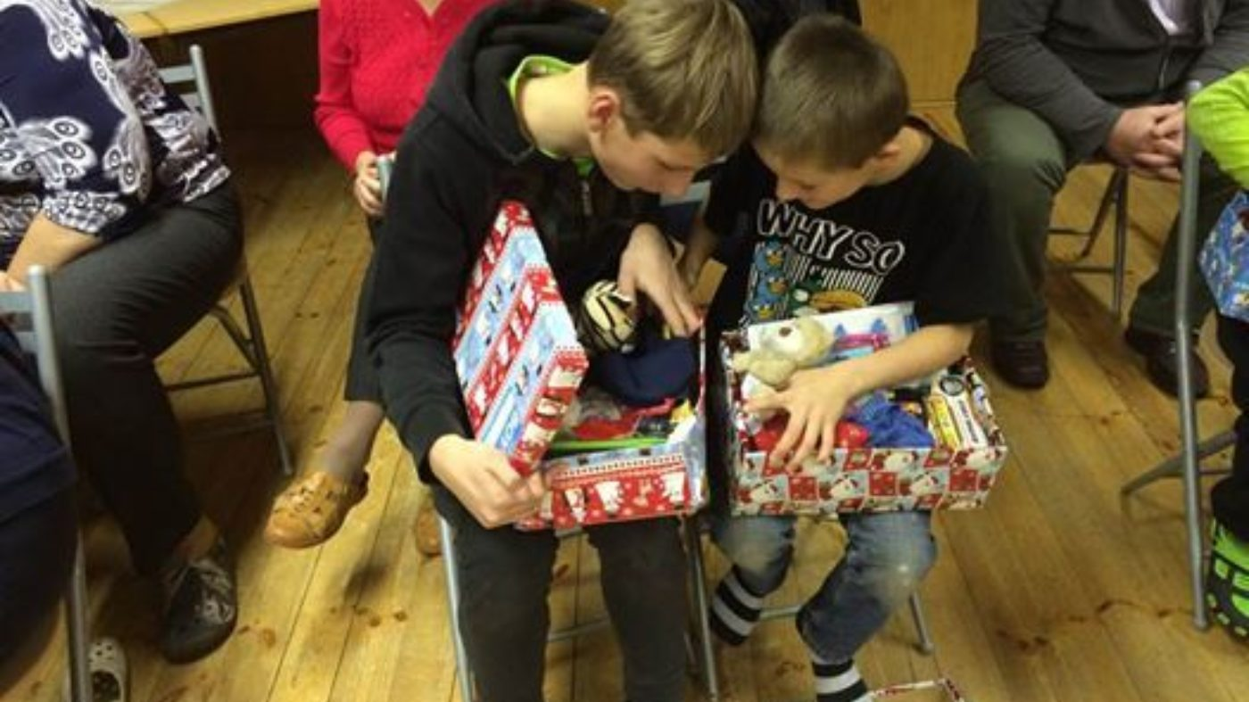 Latvian boys receiving gifts