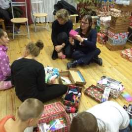 Kids receiving their Christmas gifts