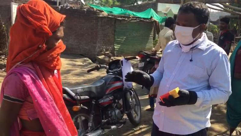 Pradeep in mask with lady